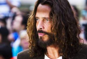 Wife of Soundgarden's Cornell calls suicide 'inexplicable'