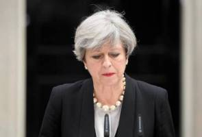 Two men charged with plotting to kill British PM