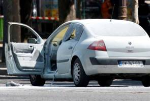Car hits police vehicle on Paris' Champs Elysees, driver arrested