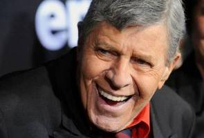 "Jerry Lewis, the high prince of low-brow comedy on stage and in movies as well as a fund-raising powerhouse with his annual Labor Day telethon, died on Sunday of ""natural causes"" at the age of 91."