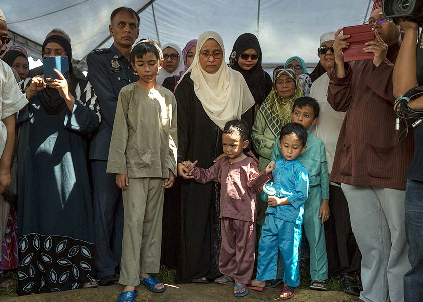 The late Major Yazmi leaves his widow, Noor Shafora Izwa Mohd Hilmi and six children, Mikhail Adam Riaz, 11, Mukhriz Anwar Riaz, 10, Muaz Addin Riaz, 7, a pair of twins, Mika Adden Riaz and Mika Addin Riaz, each 4 Ayman Riaz years and Musa Ayman Riaz, 3 years. - Astro Awani / Shahir Omar