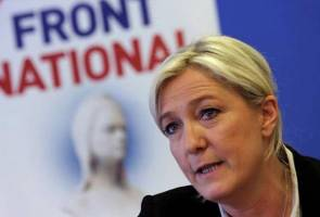 France's Le Pen wins parliamentary seat, faces turbulent times