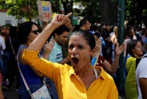 Venezuela opposition votes against Maduro, woman shot dead