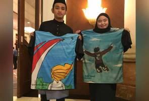 Karya lukisan terakhir mangsa MH17 diabadikan dalam bentuk kemeja-T