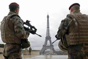 France opens terrorism probe into knife-wielding man at Eiffel Tower - source