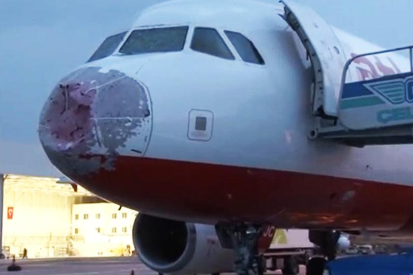 Muncung pesawat rosak teruk akibat hujan ais.