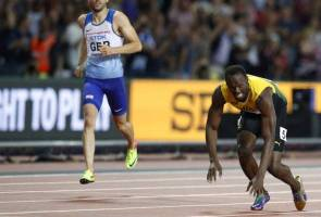 Bolt's illustrious career ends in tears after cramp downs him in final race