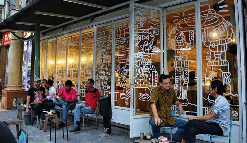 Karim Raslan and Angga Sasongko relaxing and sipping coffee at the Filosofi Kopi shop in Melawai, Jakarta. Karim Raslan Photo