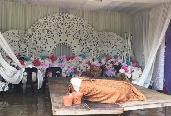 Majlis ranap dek banjir kilat, pengantin dua beradik berputih mata
