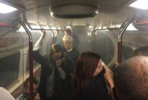 Firefighters extinguish small fire on London Underground train
