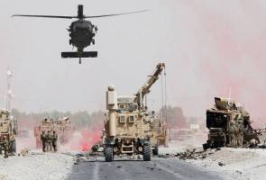 Afghan suicide bomber kills two U.S. soldiers in NATO convoy