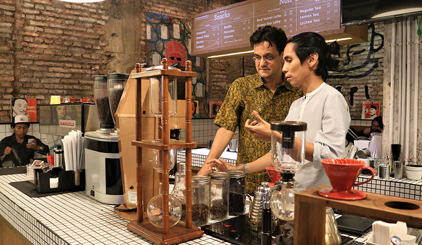 Angga Sasongko in addition to being a director of a coffee-themed film, is also good at making coffee at his shop in the Blok M Jakarta area. Karim Raslan Photo