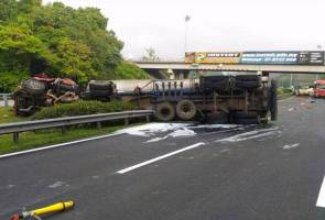 Overturned tanker lorry causes acid spillage, driver killed