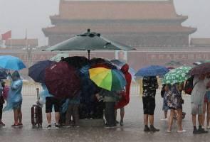 Storms disrupt Beijing flights, authorities warn of flash flooding, landslides