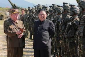Kim Jong Un praises nuclear programme, promotes sister to centre of power