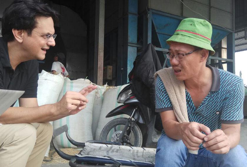 Karim speaks to Pak Darwin, a Chinese Indonesian rice miller in the city of Medan, North Sumatra. - Karim Raslan Photo