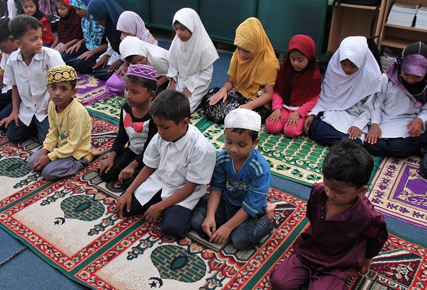 Children at the Darul Eslah Academy learn about the pillars of Islam, including prayers. Karim Raslan Photo