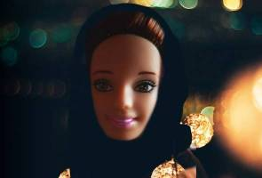 A mother's invention, Barbie-like doll recites Quran verses