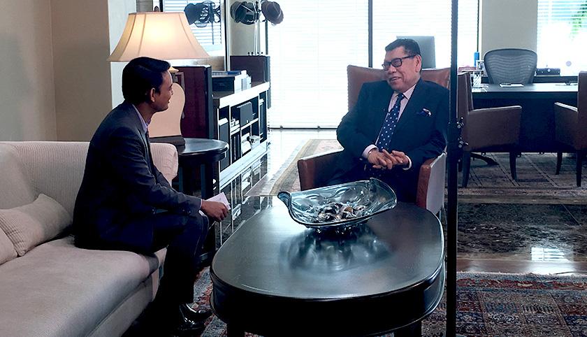 Astro AWANI's Luqman Hariz talks to Abu Sahid during the interview in Kuala Lumpur today.