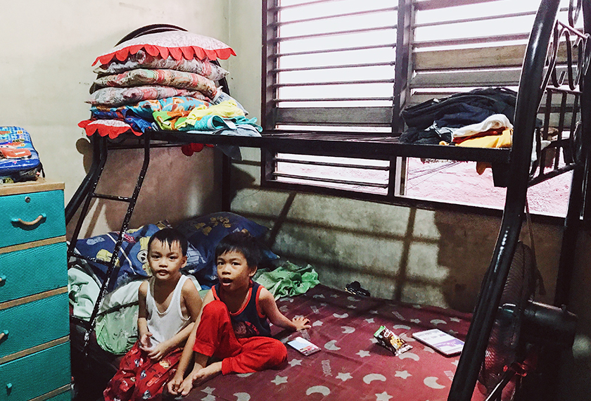 The family share two bedrooms, making do with four bunk beds and some mattresses on the floor. Karim Raslan Photo