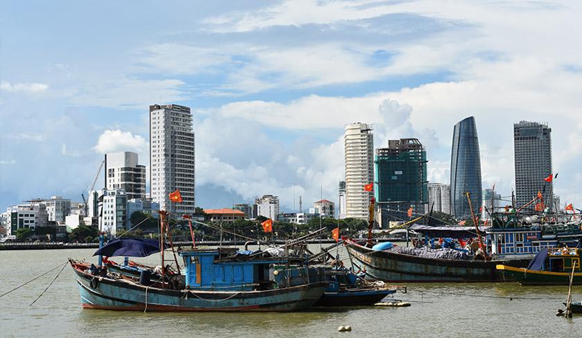 Fishing boats dot the Danang riverway. Karim Raslan Photo