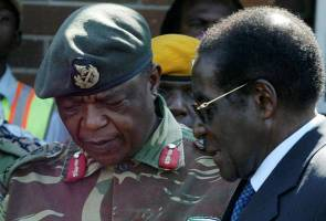 Zimbabwe military says seizes power to stop 'criminals', President Mugabe safe