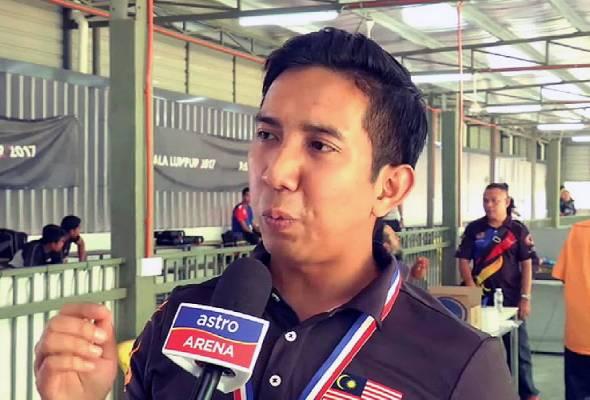 Mohd Ridhuan Mohamed, mengetepikan pesaing kuatnya, Hafiz Adzha, untuk memenangi acara 25m rapid fire pistol.