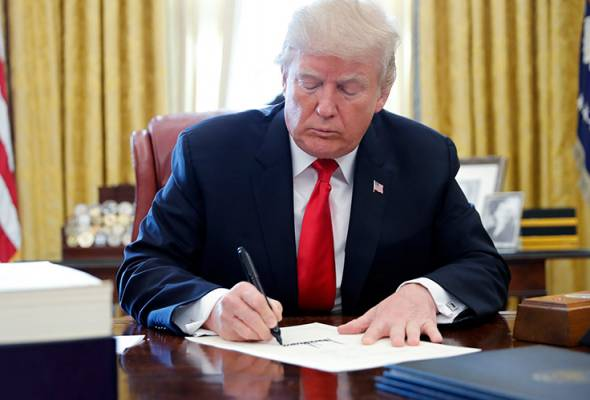Trump signs tax, government spending bills into law