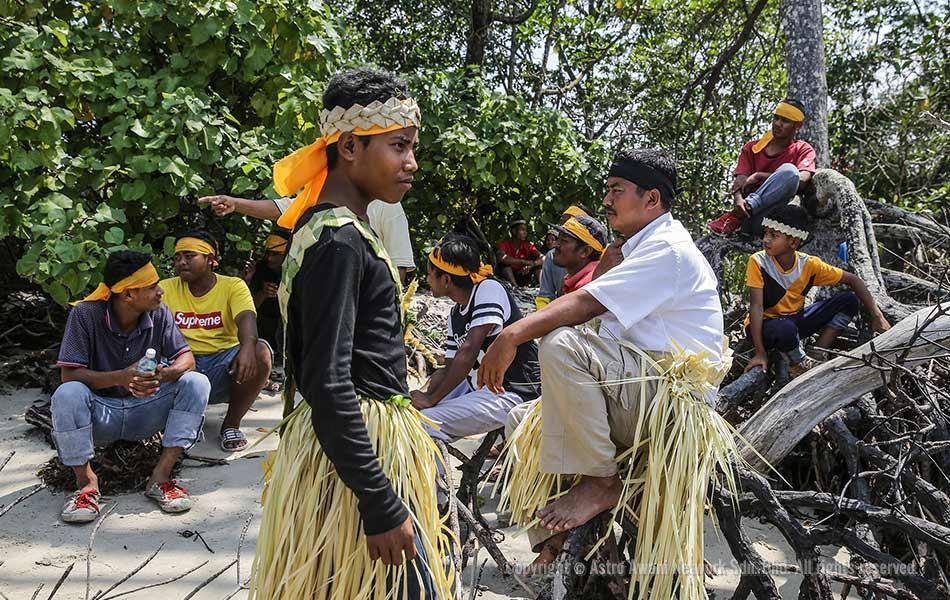 Mah Meri tribesman  waiting for low tide before