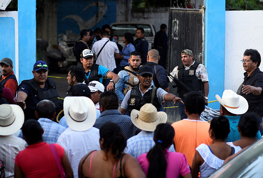 Policemen guard a crime scene where mayoral candidate Santana Cruz Bahena was gunned down at his home in the municipality of Hidalgotitlan, in the state of Veracruz, Mexico on Nov 20, 2017. - REUTERS