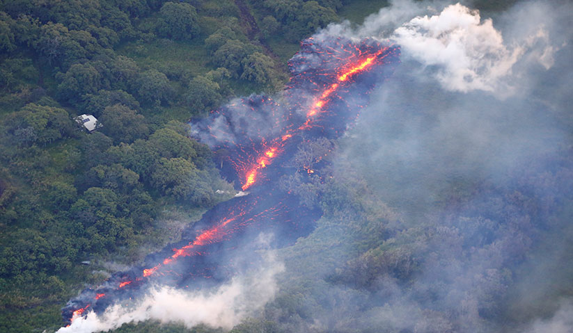 Lava erupts from a fissure east of the Leilani Estates subdivision during ongoing eruptions of the Kilauea Volcano in Hawaii, U.S., May 13, 2018. - REUTERS