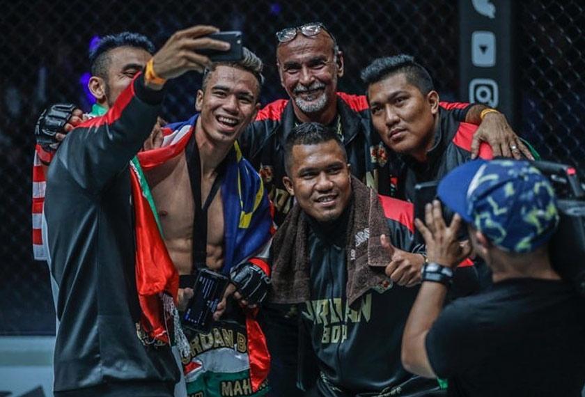 (From left) Muhammad Nidal, Jordan Boy, father Omar Mahmoud with Sampuri Muay Thai Gym head coaches Zariman and Zarimi. - ONE photo