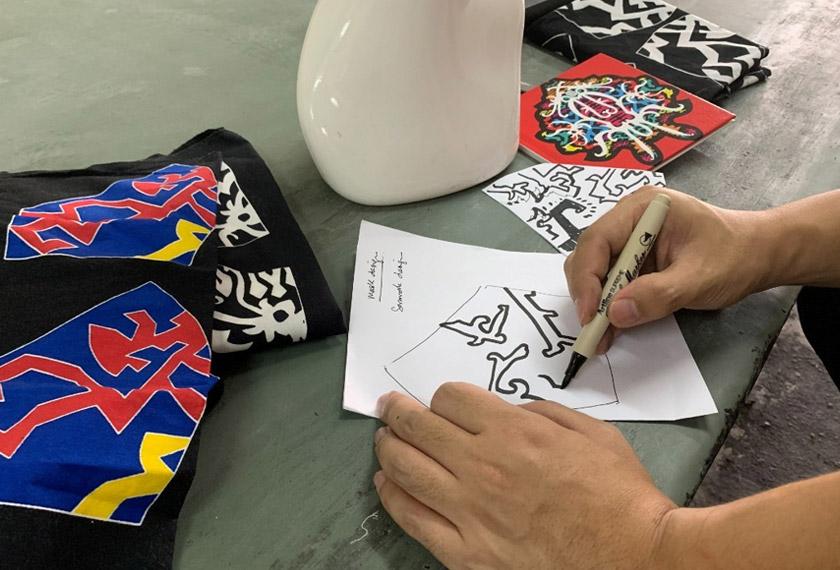 Pelitup muka dengan motif batik ini menjadi trend yang digemari di Malaysia. - Reuters