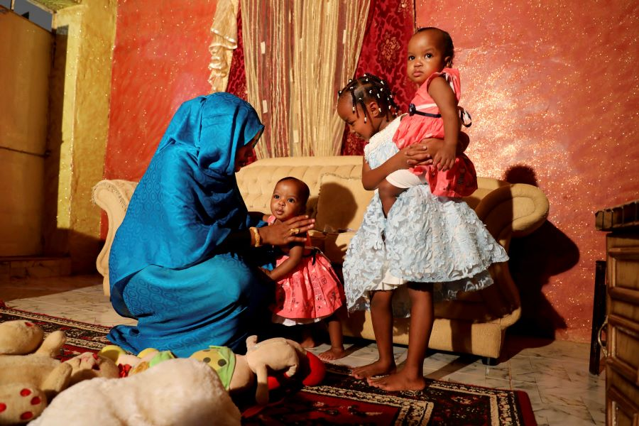 Youssria Awad plays with her daughters in their home, in Khartoum, Sudan on June 14, 2020. She refuses to carry out female genital mutilation on them, a practice that involves partial or total removal of the external female genitalia for non-medical reasons that The World Health Organization says FGM constitutes an