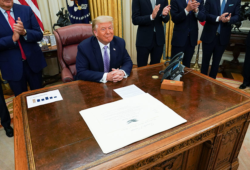 U.S. President Donald Trump receives applause after announcing that Israel and the United Arab Emirates have reached a peace deal that will lead to the full normalization of diplomatic relations between the two Middle Eastern nations in an agreement that Trump helped broker, at White House in Washington, U.S., August 13, 2020. REUTERS/Kevin Lamarque