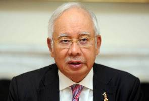 Najib not delaying to file suit against WSJ, says lawyer