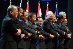 Najib, ASEAN leaders sign convention against trafficking in persons