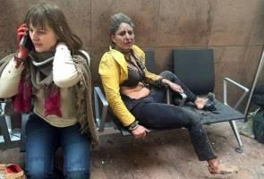 At least 26 dead as blasts rock Brussels airport, metro