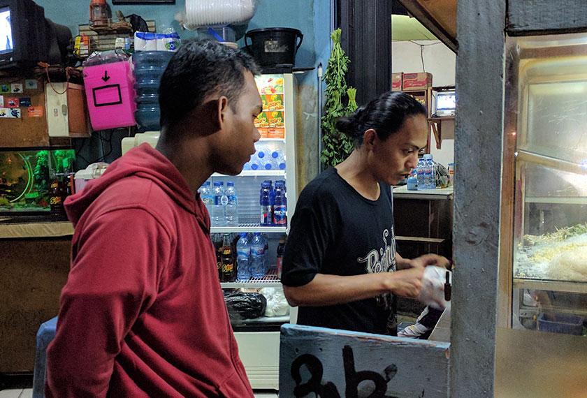 Fiki, 18, pelanggan tetap warung Pak Udin, bekerja sebagai anggota keselamatan di Hotel Indonesia. - Foto Karim Raslan