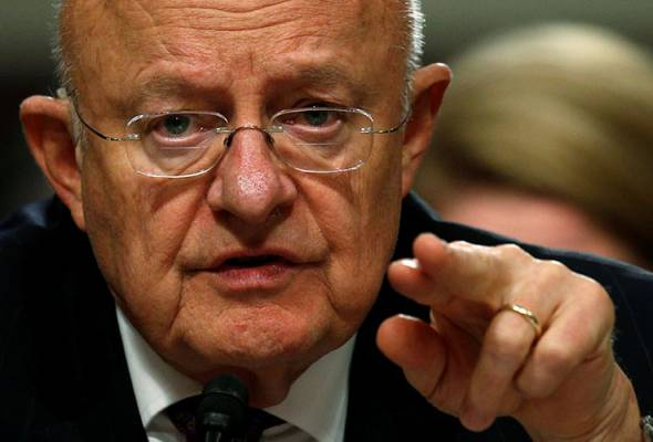 U.S. spy chief 'resolute' on Russia cyber attack, differs with Trump