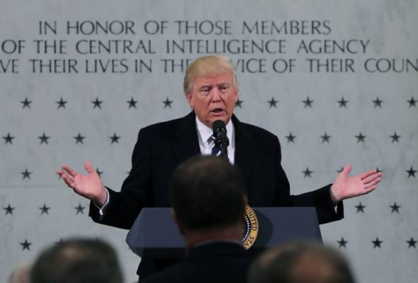 Denying feud over Russia hacking, Trump vows support to CIA