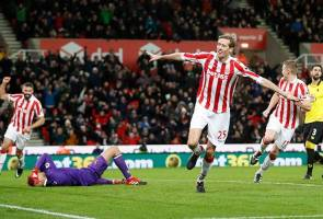 Stoke ease up to mid-table with win over Watford