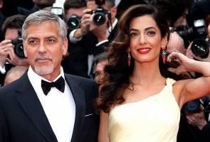 George Clooney mahu bertindak ke atas majalah sebar gambar bayi kembarnya