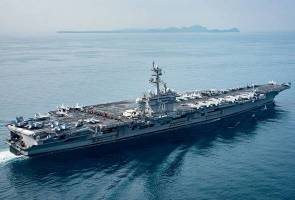 Carrier group heads for Korean waters, China calls for restraint