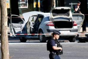 Car rams police van on Paris' Champs Elysees, driver dead