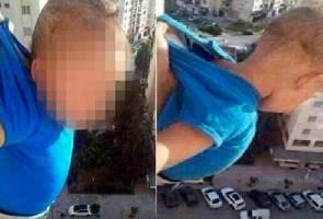 Lelaki dipenjara menghayun bayi di luar tingkap untuk dapat 'Like' Facebook