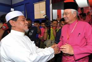 Presence of PAS leader at UMNO's event catches PM Najib's attention