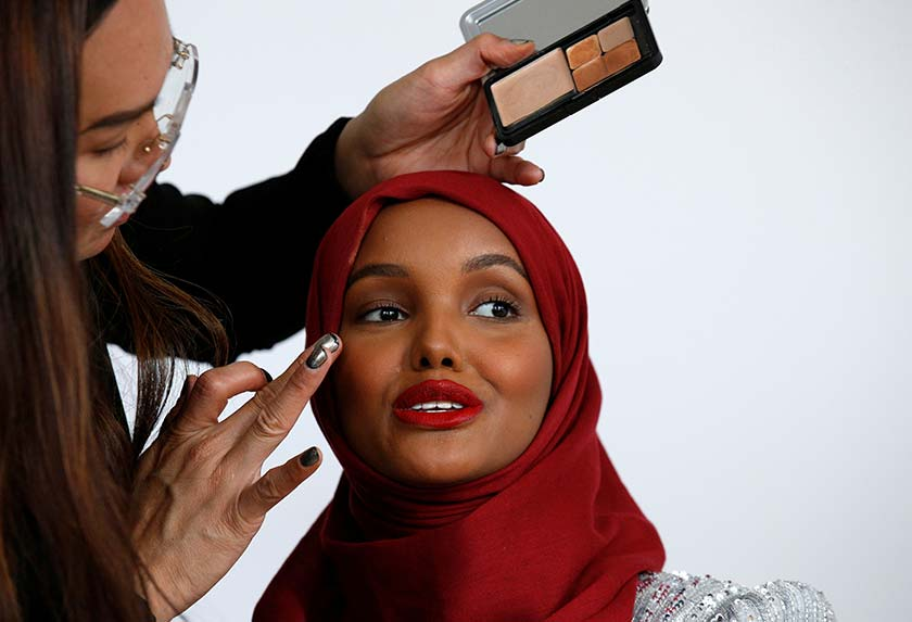 Halima has her makeup applied during a shoot at a studio in New York City on Aug 28, 2017. - REUTERS