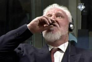 Bosnian Croat war crimes convict dies after taking 'poison' in U.N. court