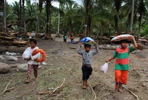 Ribut Tropika Tembin: Sambutan Krismas di pusat pemindahan